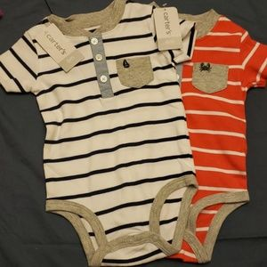 Two baby boy striped onesies